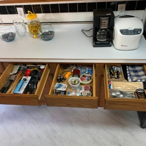 3 drawers of contents - batteries and kitchen utensils