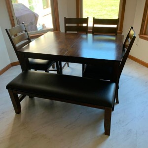 DR table, 4 chairs and bench (like new)